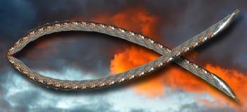 Simbolo cristiano dei pesci contro il cielo ardente immagini stock