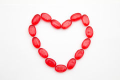 Simbolo del cuore della pagina fatto della caramella dolce Immagine Stock