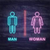 Simbolo del neon della donna e dell'uomo Immagine Stock Libera da Diritti