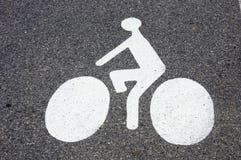 Simbolo della bicicletta sulla pavimentazione Fotografia Stock Libera da Diritti