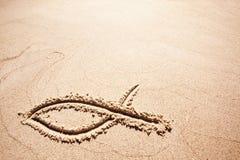 Simbolo della sabbia dei pesci fotografia stock libera da diritti
