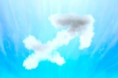 Simbolo di astrologia in materiale della nuvola - Sagittario immagine stock libera da diritti