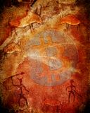 Simbolo di Bitcoin su fondo preistorico con gli animali ed i cacciatori fotografia stock
