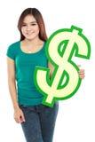 Simbolo di dollaro della tenuta della giovane donna Immagini Stock Libere da Diritti