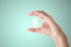 Simbolo di dollaro della tenuta della mano dell'uomo d'affari illustrazione vettoriale
