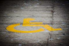 Simbolo di handicap stampato sulla via immagine stock