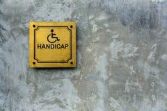 Simbolo di handicap su cemento fotografie stock