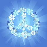Simbolo di pace con i fiori su una priorità bassa blu Fotografia Stock