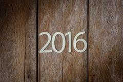 Simbolo di sospiro dal numero 2016 su vecchio retro stile d'annata t di legno Fotografia Stock Libera da Diritti