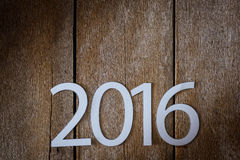 Simbolo di sospiro dal numero 2016 su vecchio retro stile d'annata t di legno Fotografie Stock