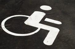 Simbolo di una persona in una sedia a rotelle Immagini Stock Libere da Diritti