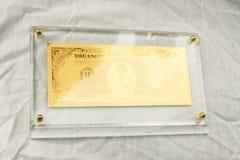 Simbolo dorato del dollaro Fotografia Stock