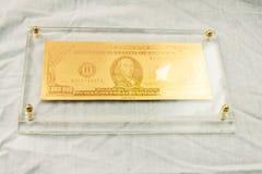 Simbolo dorato del dollaro Immagine Stock