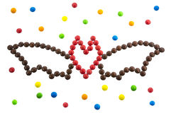 Simbolo Halloween - un pipistrello dalle caramelle rotonde isolate Fotografie Stock