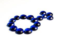 Simbolo maschio dissipato con le pietre blu Immagini Stock