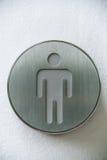Simbolo maschio fatto da metallo sui precedenti bianchi Fotografia Stock Libera da Diritti