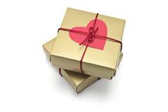 Simbolo rosso del cuore sui contenitori di regalo Fotografia Stock