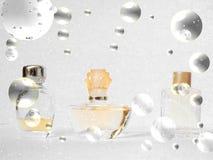 Simbols christmas perfume bottles. Simbols christmas three perfume bottles in the bubbles and snow  on white background Stock Photos