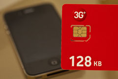 Simcard. New simcard placed to new smartphone Royalty Free Stock Photography