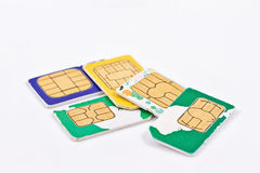 Simcards of different mobile service providers and russian money Royalty Free Stock Photos