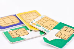 Simcards of different mobile service providers and russian money Stock Photography