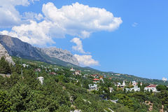 Simeiz settlement and clouds over the mountain Ai-Petri, Crimea Stock Photo