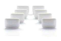 Simetría blanca de la tableta del chicle imagen de archivo libre de regalías