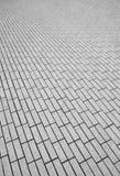 Simetría de la piedra de pavimentación fotografía de archivo libre de regalías