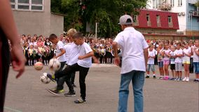 SIMFEROPOL, CRIMEA. 01.09.2015. Boys Playing Balls At School Line At Knowledge Day stock video footage
