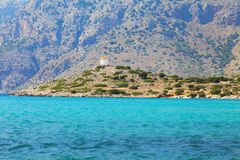 Simi island and windmills. The turquoise sea and windmills on the island of Simi Stock Photo