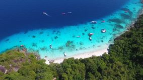 Similan Islands Aerial Beach View. Beautiful White Sandy Beach and Clear Blue Water. HD birds eye view shot. Thailand. stock footage