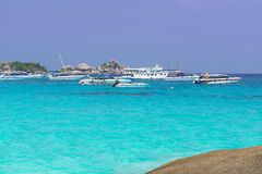 Similan islands. Speed boats waiting tourists on one of the Similan islands, Thailand Stock Photo