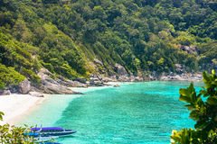 Similan islands. Speed boats waiting tourists on one of the Similan islands, Thailand Stock Photos