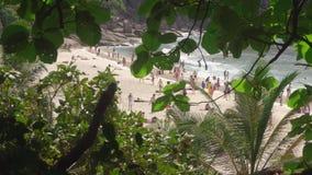 Similan National Park tropical beach island in Thailand. SIMILAN ISLANDS, THAILAND - NOVEMBER 24, 2016: Tourists on Koh Similan No.8 Island with Sailing Boat stock video