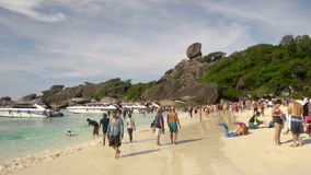 Similan National Park tropical beach island in Thailand. SIMILAN ISLANDS, THAILAND - NOVEMBER 24, 2016: Arrival of the boats with tourists on Koh Similan No.8 stock footage