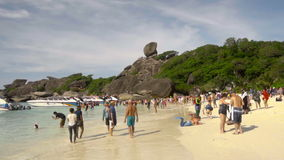 Similan National Park tropical beach island in Thailand. SIMILAN ISLANDS, THAILAND - NOVEMBER 24, 2016: Arrival of the boats with tourists on Koh Similan No.8 stock video