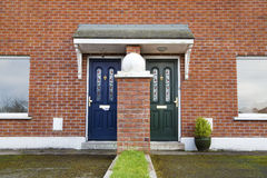 Similar but different entrance door Stock Photos