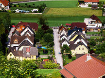 Similar house roofs over view. Countryside, Austria Stock Photos