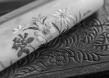 Similar but not the same. Embroidery and carving. Black and white photography stock photo