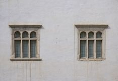 Similarities with differences. Two windows of the fortress of Fagaras - Romania photographed this spring Stock Photos