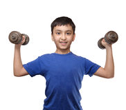 Similing boy exercise with dumbbells Stock Images
