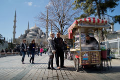 Simit's vendor before Blue Mosque. A typical simit (turkish traditional street food) before the Sultan Ahmed Mosque in Instanbul. The mosque is popularly known Stock Images