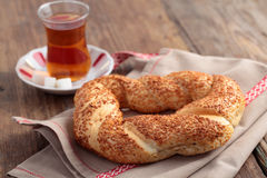 Simit and tea. Turkish bagel, simit, and traditional tea on a table Stock Photography