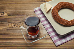 Simit - turkish bagel, tea and cheese on wood table Royalty Free Stock Image