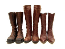 Simlar but different. Three par of brown leather boots isolated on white background Stock Photos