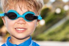 Simmare Boy Wearing Goggles Arkivbilder
