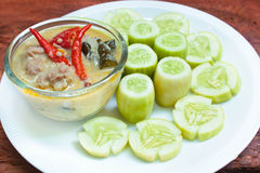 Simmer pork chops with cucumber. Stock Photos