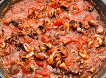 Simmering tomato and sea food spagetti sauce Royalty Free Stock Photo