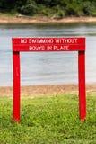 Simning som varnar Signl Arkivbild