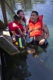 Simningkurser - Merritts maler dammet arkivfoto
